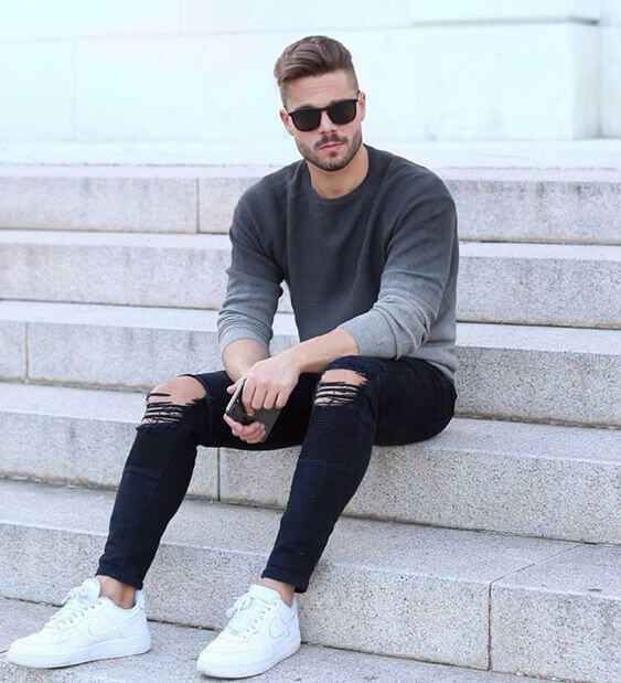 Coolest white sneakers style on black denim jeans