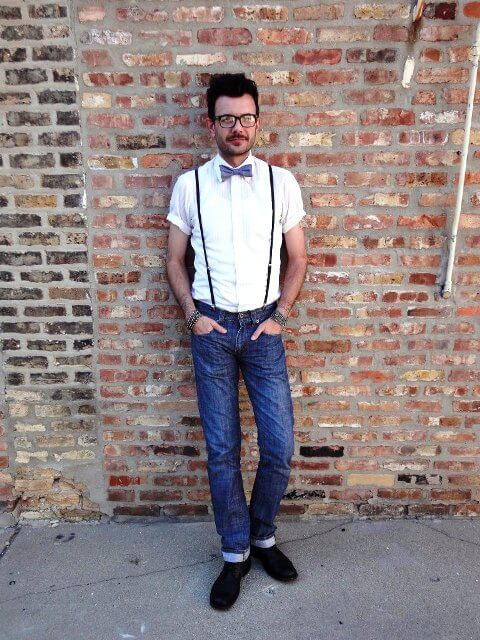 short sleeve shirt with bow tie and suspenders men photoshoot poses white shirt combination