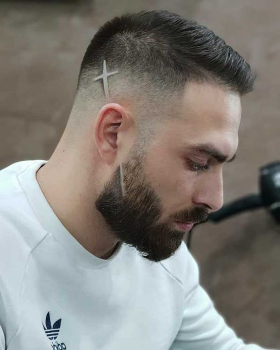 short sided faded hair cut with line design | fade hair cut design with beard